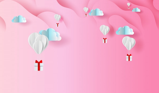 Balloons gift on abstract curve shape pink sky background
