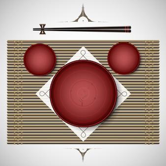 ランチ伝統的なスタイルのためのプレートと箸の設定の竹マット