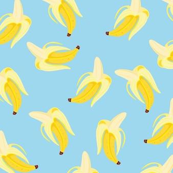青い背景の上のバナナパターンの背景。図