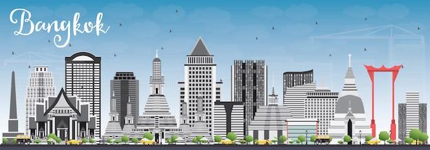 Bangkok skyline with gray landmarks and blue sky.