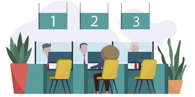 Менеджеры банка разговаривают с клиентами в фойе