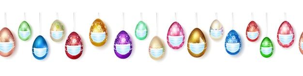 Баннер из реалистичных подвесных пасхальных яиц разных цветов с красочным декором в медицинских масках на белом