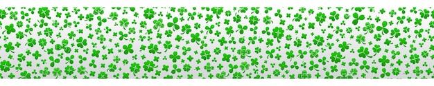 Баннер в день святого патрика из листьев клевера в зеленых тонах с бесшовным горизонтальным повторением