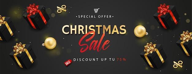 크리스마스 판매 배너 또는 포스터. 선물 상자, 황금 반짝이 공, 색종이와 붓글씨 텍스트.