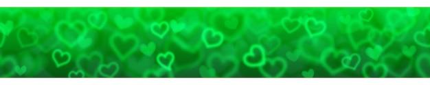 水平方向のシームレスな繰り返しで緑色のぼやけた心を持つバナー。バレンタインデーのイラスト