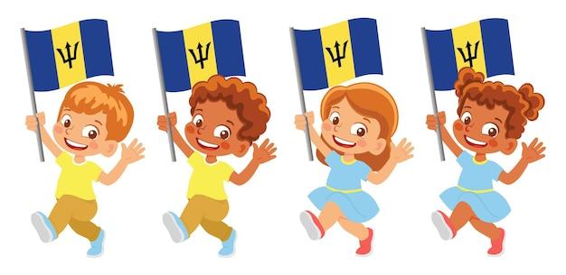 Флаг барбадоса в руке. дети держат флаг. государственный флаг барбадоса