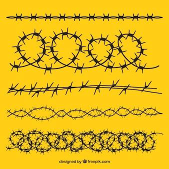 Набор колючей проволоки на желтом фоне