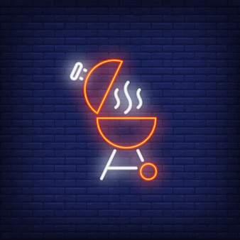 Barbeque grill with open lid and smoke neon sign