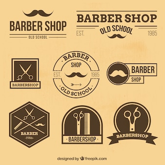 Barber shop logos in retro style Premium Vector