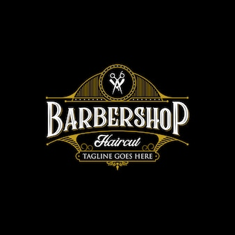 Barbershop vintage logo design. vintage lettering premium illustration on dark background.