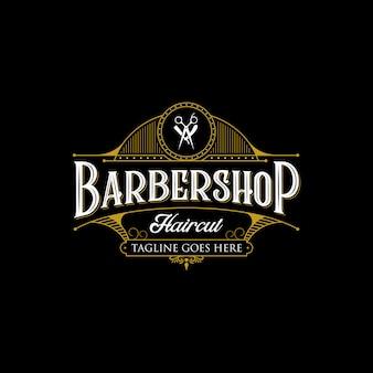 理髪店のビンテージロゴデザイン。暗い背景にヴィンテージのレタリングプレミアムイラスト。