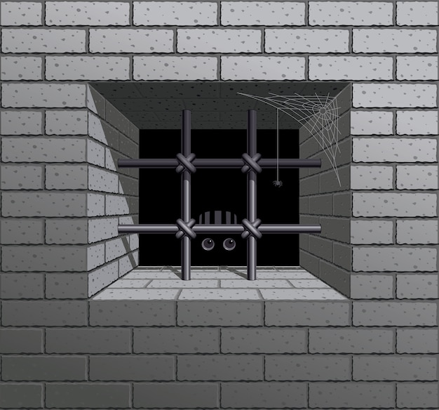 Barred window in the brick wall