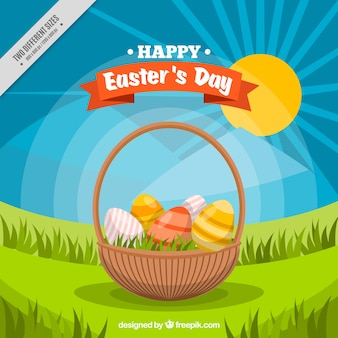 Basket background with easter eggs on the grass