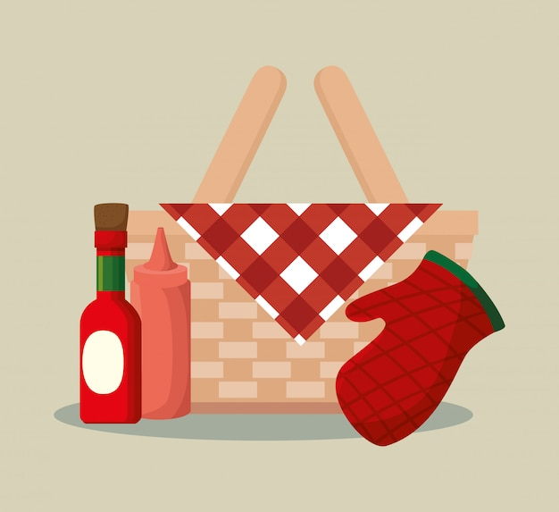 Basket wicker barbecue with bottles and glove
