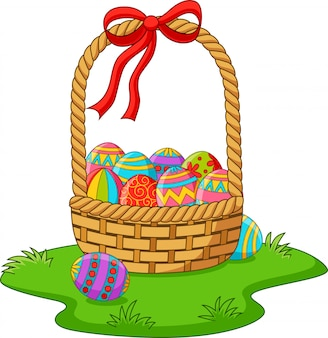 Basket with easter eggs in the grass