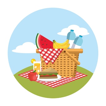 Basket with water bottles and food in the tablecloth