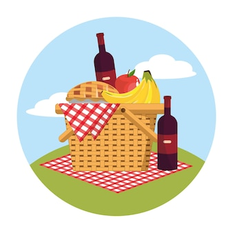 Basket with wines bottle and fruits in the tablecloth