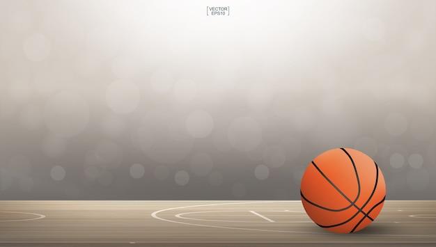 Баскетбольный мяч на площади баскетбольной площадки.