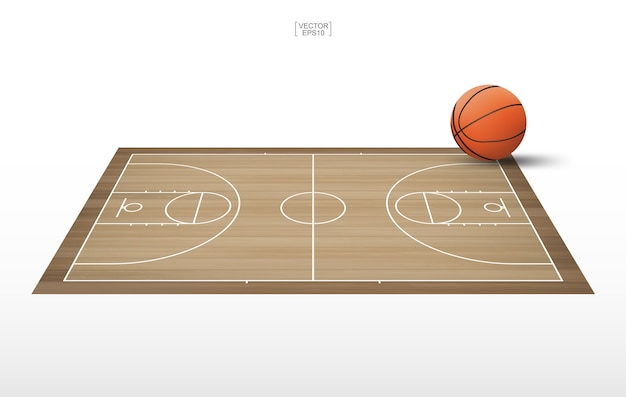 Basketball ball on wooden court.
