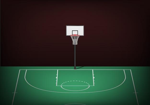 Basketball hoop on empty green court.