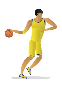 Basketball player in yellow uniform with the ball