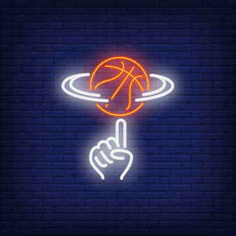 指のネオンサインでバスケットボールスピニング