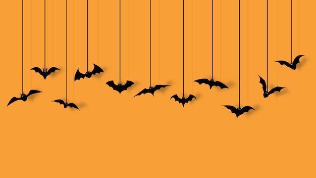 오렌지 배경에 고립 된 할로윈 파티에 대 한 박쥐 장식.