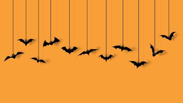 Bat decoration for halloween party isolated on orange background.
