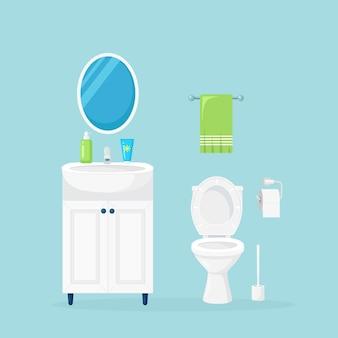 便器とタオル付きのバスルームのインテリア