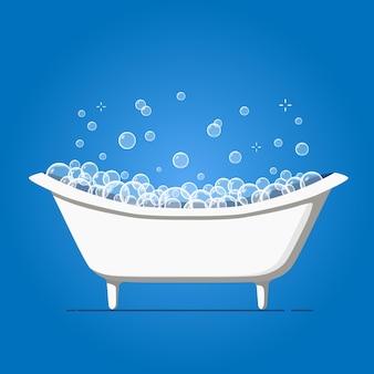 シャボン玉付きのバスタブ。青の背景に風呂の泡シャワー。
