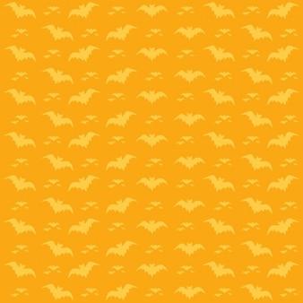 オレンジ色の背景にコウモリパターン