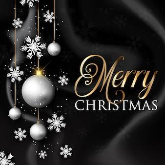クリスマスのbaublesと黒の大理石のテクスチャの雪片