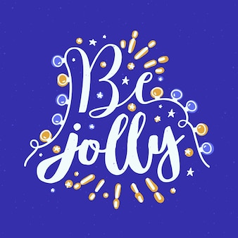Be jolly holiday wish written with cursive calligraphic font and decorated by glowing light garland