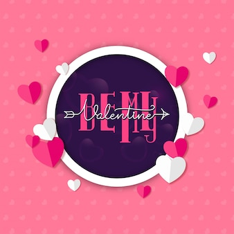 Be my valentine font in purple circle shape decorated with paper cut hearts on pink