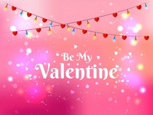 Be my valentine lettering on pink bokeh background decorated wit