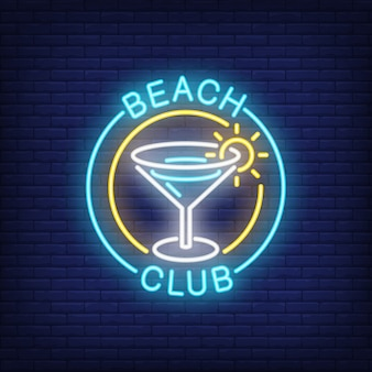 Beach club lettering and cocktail in circle.