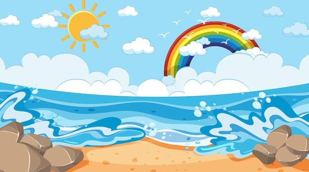 Пляжный пейзаж в дневное время с радугой в небе