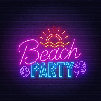 Beach party neon sign on brick wall.