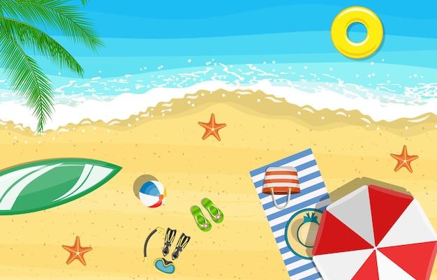 Beach sun umbrellas flip-flops and beach mat