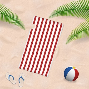 Beach towel in sand summer background
