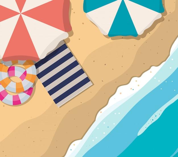 傘が浮かぶビーチとタオルトップビューデザイン、夏休み