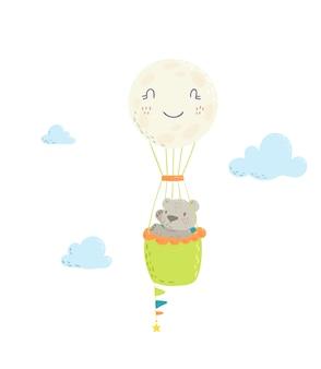 クマは熱気球に浮かんでいます