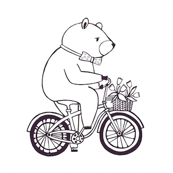 Bear on the bicycle with basket and flowers.