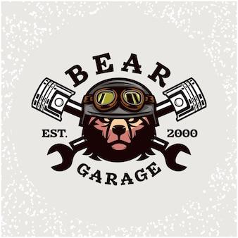 クマの頭の自動車修理とカスタムガレージのロゴ。