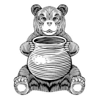 蜂蜜の瓶を保持しているクマ