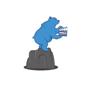 Bear standing on the rock holding movie clip Premium Vector
