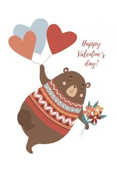 Мишка с букетом цветов летит на воздушных шарах в форме сердца