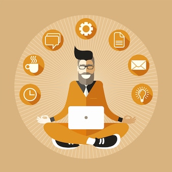 Bearded and bespectacled hipster programmer with a laptop meditating in sukhasana easy pose.