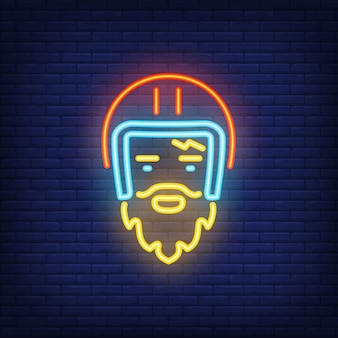 Bearded biker wearing helmet on brick background. Neon style illustration.