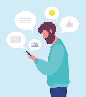 수염 난된 남자 온라인 채팅 또는 스마트 폰 또는 휴대 전화에 문자 메시지.